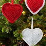 Crocheted Christmas Love Hearts. Hanging red hearts and red with white accents || thecrochetspace.com