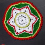Crocheted Party Doily Coasters. One coaster up close image in red, green and white || thecrochetspace.com