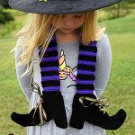 Crocheted Witches Legs Scarf . Little girl wearing one scarf in black and purple || thecrochetspace.com