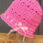 Cute Crochet Cloche Hat. Pink,lace hat with pale pink ribbon threaded through || thecrochetspace.com