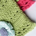 Cute Crochet Cloche Hat. Close up of two lacy, airy hats. One crafted in pink and the other in green || thecrochetspace.com