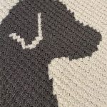 Dapper Dogs Crochet Afghan. Close up of head of dog on afghan || thecrochetspace.com