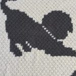 Dapper Dogs Crochet Afghan. Another pose of the dog with a cream collar on || thecrochetspace.com
