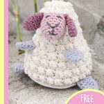 Delightful Crocheted Easter Lamb. White lab with pink face and blue legs and arms || thecrochetspace.com