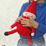 Delightful Crocheted Santa. Dressed in red with long, thin legs || thecrochetspace.com