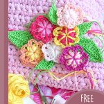 Double Rosella Crochet Flower. Crafted on pink background. Bunch of multi-colored flowers with leaves    thecrochetspace.com
