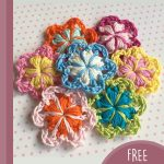 Double Rosella Crochet Flower. Crafted on a nutral background in multi-colors    thecrochetspace.com