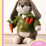 Easter Crochet Big Bunny. One bunny standing in his green jacket with two carrots in his top pockets and holding a third || thecrochetspace.com