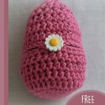 Easter Crochet Bunny Surprise. Closed egg crafted in pink with daisy on front || thecrochetspace.com