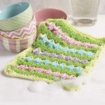 Egg Time Crochet Scrubber. Multicolored. Every other row is either green grass or a row of eggs || thecrochetspace.com