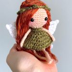 Easy Amigurumi Forrest Fairy. Sitting in the palm of a hand, and wearing a green leaf garland || thecrochetspace.com