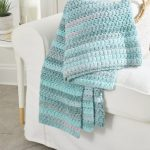 Easy Aston Crochet Throw. Throw on a sofa. Folded and in different blues || thecrochetspace.com