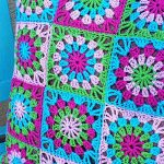 Easy Crochet Granny Pillow. Close up of Pinks, Blue and green granny squares || thecrochetspace.com