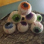 Easy Halloween Crochet Eyeballs. Stacked in a pyramid shape || thecrochetspace.com