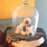 Easy Halloween Crochet Eyeballs. Sitting under a covered,glass dome || thecrochetspace.com