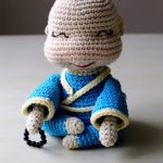 Easy Happy Amigurumi Buddha. Sitting position in a blue kimono edged with yellow || thecrochetspace.com