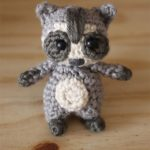 Easy Mini Crochet Raccoon. raccoon crafted in grey cream and black || thecrochetspace.com
