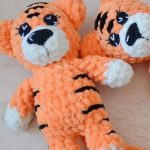 Easy Mini Crochet Tiger. 2x tigers crafted in bright orange with black accent markings || thecrochetspace.com