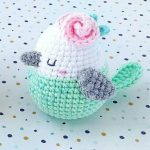 Easy Spring Crochet Bird. Crafted in turqouoise, white and grey with a pink rose on it's head || thecrochetspace.com