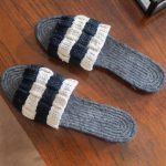 Easy Summer Crochet Espadrilles. Image of espadrilles not being worn. Black espadrille soles with white and blck crochet rectangle bar across toes || thecrochetspace.com