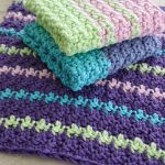 Easy Textured Crochet Dishcloth. 2x stcaked dishcloths on top of one open dishcloth || thecrochetspace.com