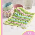 Egg Time Crochet Scrubber. Crafted to look like a grassy field with Easter eggs in it || thecrochetspace.com