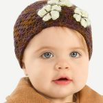 Fall Crochet Baby Beanie. Crafted in brown with cream applique flo9wers || thecrochetspace.com