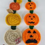 FallingPumpkin Crochet Hanging. Two, vertical, hanging rows of three pumpkins in three different sizes and colors. Some with faces | thecrochetspace.com