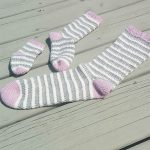 Adult Summer Crochet Socks. Three different size socks. Toe and heel crafted in pale pink and sock body crafted in grey and white stripes || thecrochetspace.com