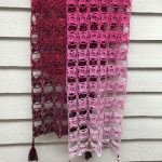 Fancy Flora Crochet Shawl. Burgundy shawl, folded and hanging. Beautiful ombre shades || thecrochetspace.com