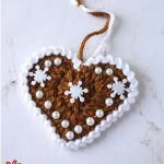 Festive Crochet Ginger Hearts. One lovely heart with pearls and white accents || thecrochetspace.com