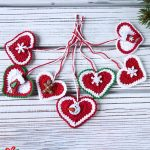 Festive Crochet Holiday Hearts. Many thanging hearts with cords together || thecrochetspace.com