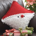 Festive Santa Crocheted Pillow. Diagonal design. half crafted in solid red and other half in a white, Santa face || thecrochetspace.com