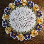Flora Crochet Pansy Doily. Crafted in Spring colors blue and yellow || thecrochetspace.com