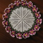 Flora Crochet Pansy Doily. Crafted in Winter colors, dark plum and greens || thecrochetspace.com