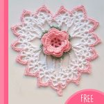 Flower Heart Crochet Doily. White, lace heart with pink edging and pink rose in the center || thecrochetspace.com