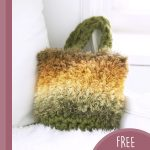 Fluffy Crystal Crochet Bag. Bag laid in a white chair || thecrochetspace.com