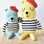 French Beret Crochet Bear. Two Bear arm in arm, one yellow and one blue, both with striped sweater and beret || thecrochetspace.com