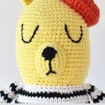 French Beret Crochet Bear. Close of one bear's face and red beret || thecrochetspace.com
