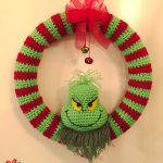 Fun Grinch Crocheted Wreath. Crafted in red and green and with accent red bow    thecrochetspace.com