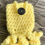 Fun Hand Sanitizer Crochet Key-Chain In The Shape Of An Octopus. Corcheted In Bright Yellow And With A Button Seal || thecrochetspace.com