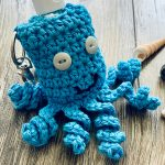 Fun Hand Sanitizer Crochet Key-Chain In The Shape Of An Octopus, With Curly Tentacles And In Blue || thecrochetspace.com