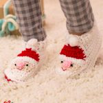 Fun Santa Crocheted Slippers. Child wearing slippers || thecrochetspace.com