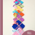 Gift Wrap Crochet Boxes. A vertical row of 7, differently colored gift boxes || thecrochetspace.com