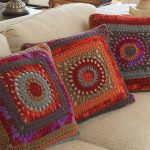 Granny Circle Crochet Pillow. Three similar pillows in different but matching colors. One large granny square on front || thecrochetspace.com