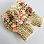Granny Fingerless Crochet Mitts. Two fingerless mitts both empty. and one on top of the other. Gorgeous pastel colors with deep cream ribbing for wrist || thecrochetspace.coms