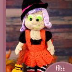 Halloween Amigurumi Witch Doll. Image of doll in organde dress with broom at her side || thecrochetspace.com