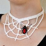 Halloween Crochet Web Necklace. White necklace with black widow spider added as accent. Shown being worn || thecrochetspace.com