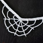 Halloween Crochet Web Necklace. Necklace on black background. No spider accent || thecrochetspace.com