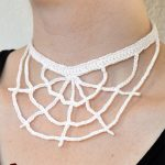 Halloween Crochet Web Necklace. White necklace with no spider accent shown being worn || thecrochetspace.com